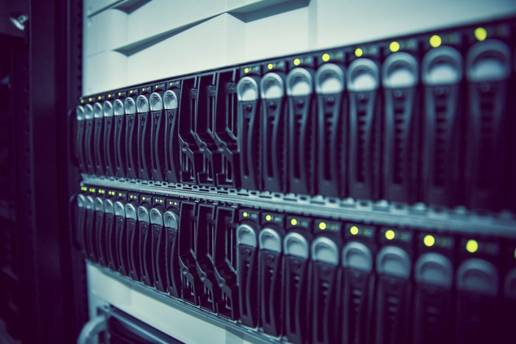 Black rack mounted server tower in large data center